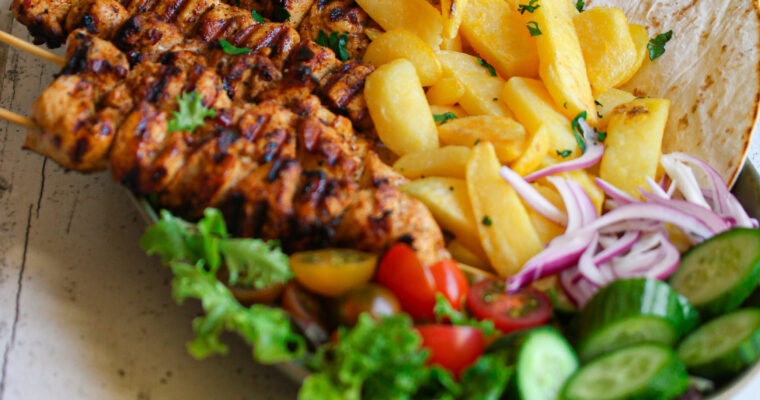 Greek Chicken Souvlaki Skewers with Oven Chips and Crunchy Salad
